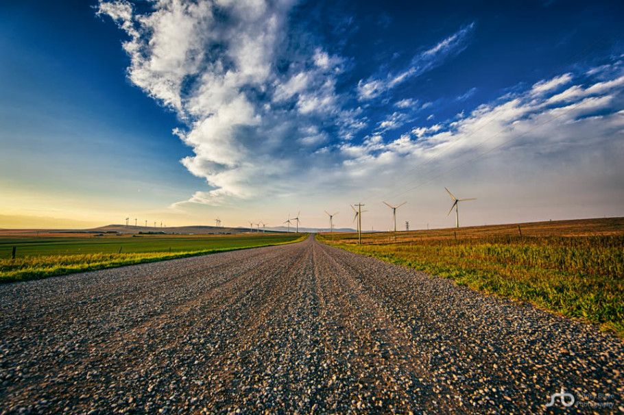 Photography vs. Life »» Sidney Blake Photography, Pincher Creek windfarm at sunset from the gravel road perspective - Sidney Blake Photography.